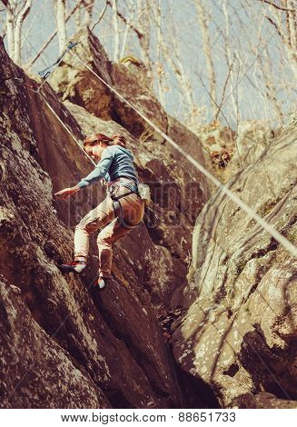 Woman Climbs Down On A Safety Rope