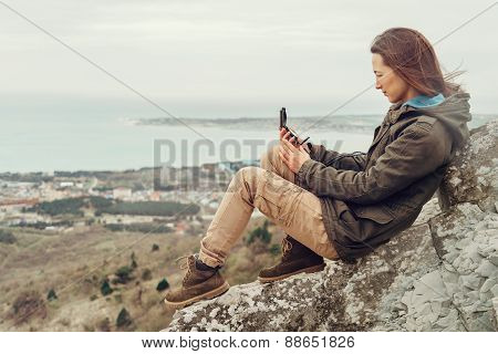 Hiker Young Woman Searching Direction With A Compass