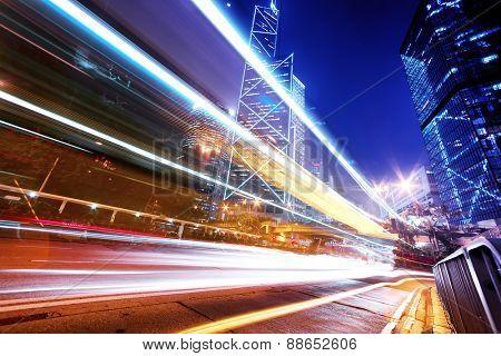traffic light trails in modern city street
