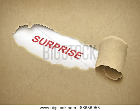 The Word Surprise Behind Torn Paper