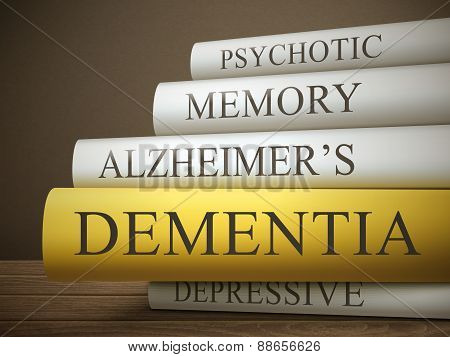 Book Title Of Dementia Isolated On A Wooden Table