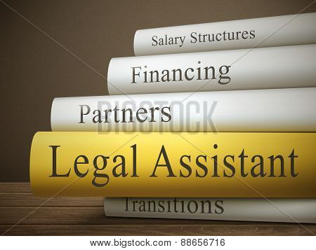 Book Title Of Legal Assistant Isolated On A Wooden Table