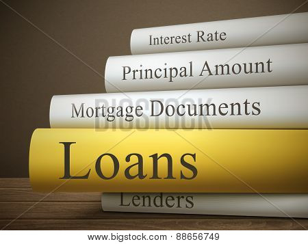 Book Title Of Loans Isolated On A Wooden Table