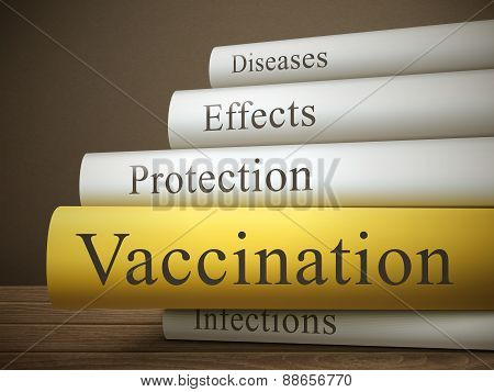 Book Title Of Vaccination Isolated On A Wooden Table