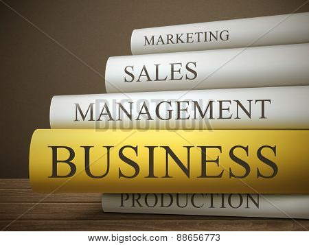 Book Title Of Business Isolated On A Wooden Table