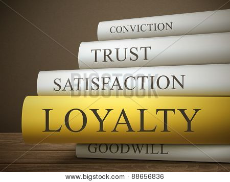 Book Title Of Loyality Isolated On A Wooden Table