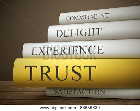 Book Title Of Trust Isolated On A Wooden Table