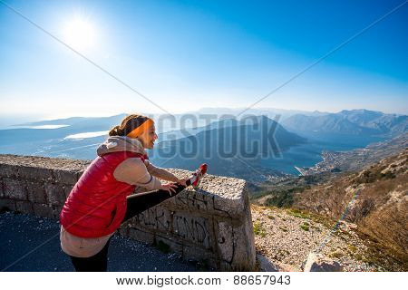 Woman having exercise on the mountain road