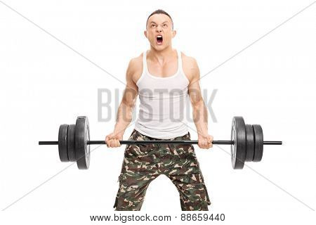 Young determined bodybuilder lifting a heavy weight and shouting isolated on white background