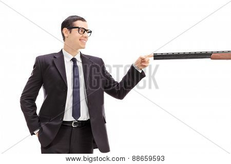 Man plugging a barrel of a rifle with his finger isolated on white background