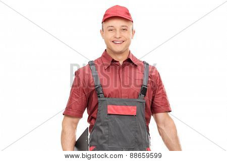 Young joyful mechanic in a gray jumpsuit isolated on white background
