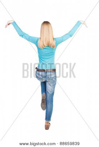 Balancing young woman.  or dodge falling woman. Rear view people collection.  backside view of person.  Isolated over white background.