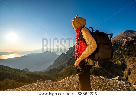 Young traveler photographer on the mountain