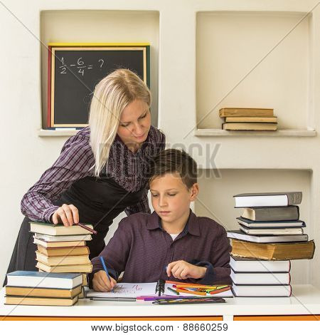 Young student learns at home with a his tutor.