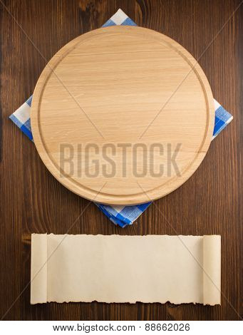 napkin cloth and cutting board on wooden background