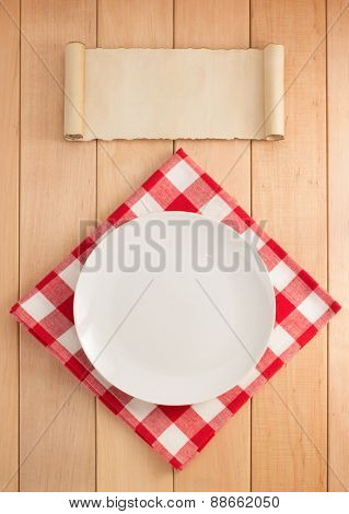 plate and napkin on wooden background