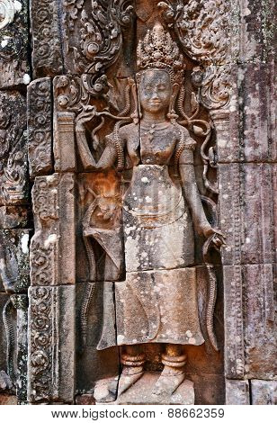 Apsaras and bas relief wall carving in Banteay Kdei, Angkor Wat
