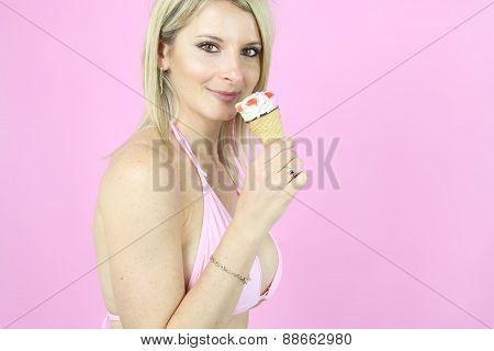 beautiful blonde in bikini eating an ice cream