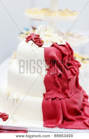 Wedding Cake In White And Wine Red With Flowers