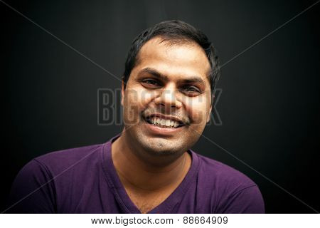 Handsome Indian man laughing