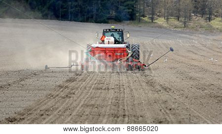 Valmet 8550 Tractor And Seeder On Field At Spring