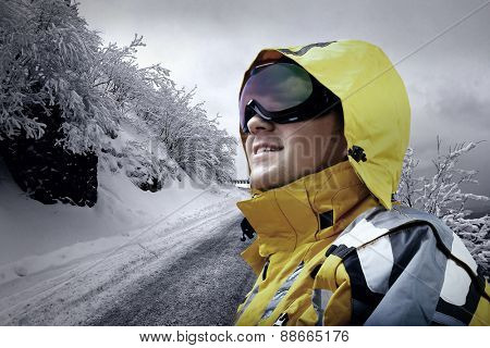 Portrait of man wearing a glasses on the background of snow winter and mounts.