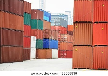 Stack of freight container boxes after sorting in warehouse dock terminal of cargo sea port