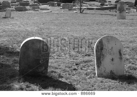 Two Old Tombstones In Black & White