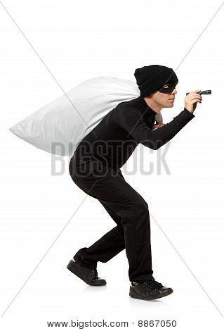 Thief Carrying A Bag And Holding A Torch