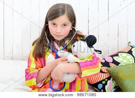 A Sick Little Girl Playing With Her Teddy