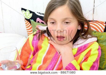 A Little Girl Has A Sore Throat