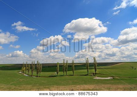 Country Landscape In Romania With Poplars And A Lake