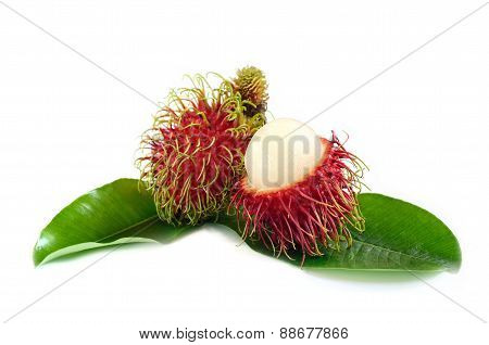 Fresh rambutan and leaves isolate on white background