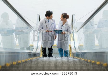 Medical Workers On Escalator