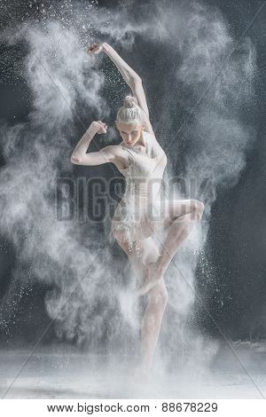 female dancer dirty in white flour