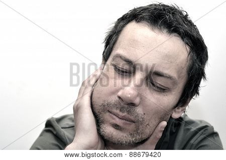 Young Man Suffering From Toothache, Teeth Pain, Having A Swollen Face