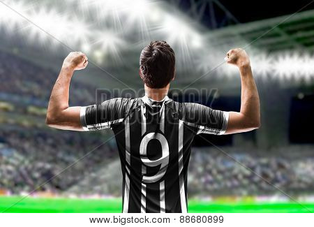 Soccer player on white and black t-shirt in the stadium