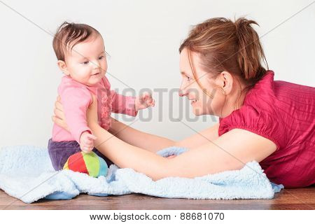 Mum Playing With Her Little Daughter