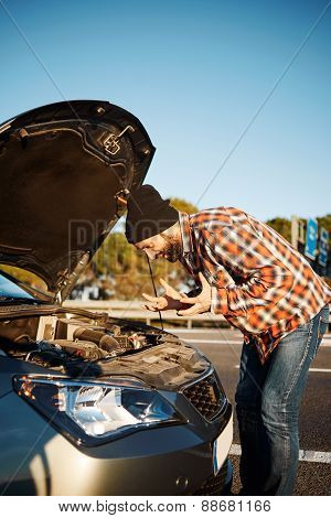Young Male Standing By Car And Looking At Broken Down Car Vehicle Engine And Try To Find Problem