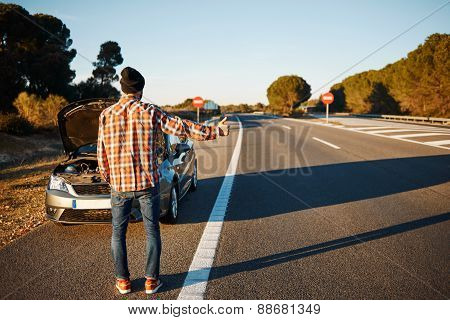 Cars - Driver Trying Stop Car In Travel Because His Car Broken. Young Man Stand On Freeway