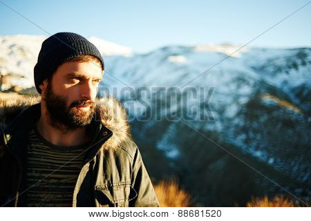 Hikers - People Hiking. Bearded Active Man Standing In The Sunset And Enjoying The Golden Sunlight.