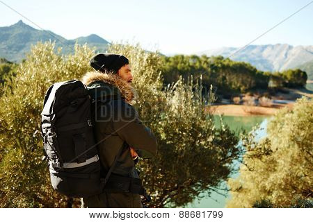 Hiking. Adventure Hiking Man. Portrait In Mountain Landscape. Caucasian Male Hiker Smiling In Nature
