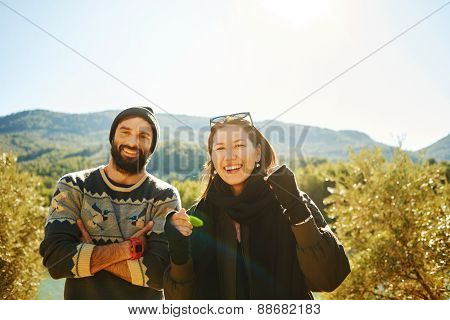 Hiking. Hiker Couple Portrait - Hikers In Mountain Enjoying View Of Nature Landscape Looking At Came