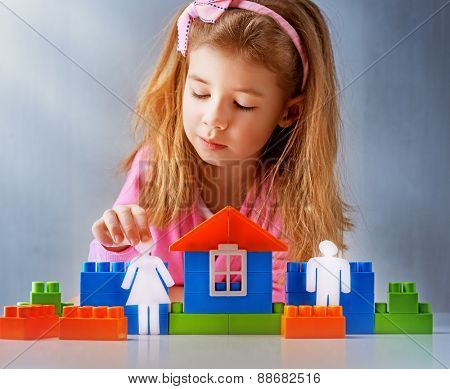 little child playing with toys