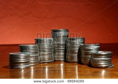 Pile of coins in pyramid form