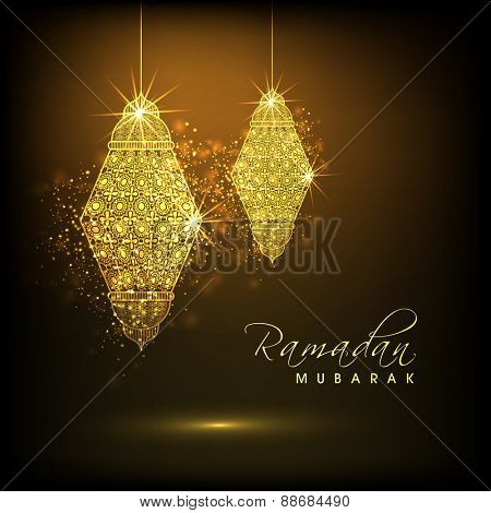 Shiny illuminated hanging golden arabic lamps or lanterns on brown background for holy month of muslim community, Ramadan Kareem celebration.