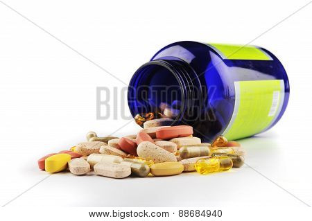 Blue Pill Bottle Container And Assorted Pills