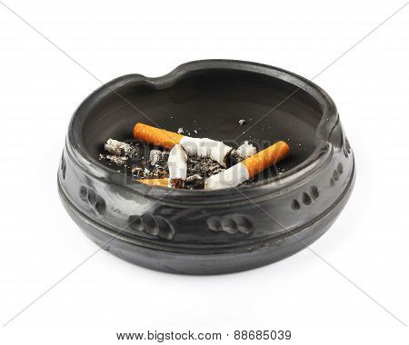 Three Extinguished Cigarettes In A Black Ashtray