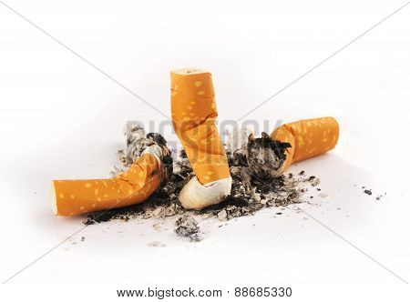 Three Extinguished Cigarettes With Ashes