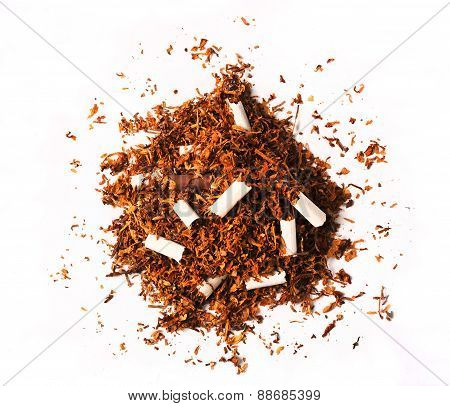 Pile Of Tobacco Leaves With Broken Cigarettes